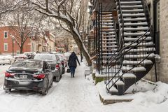 Snow storm in Montreal. Pedestrian walking on a sidewalk royalty free stock photo