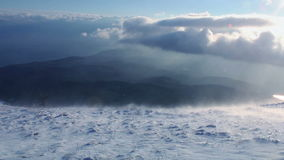 Snow storm in mountains stock footage