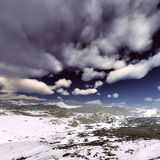 Snow storm in the mountains. Winter day Royalty Free Stock Image