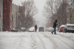 Snow storm pedestrians Stock Photography