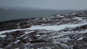 Snow storm on the rocky shores stock video