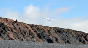 Snow summit in clouds, Iceland. Royalty Free Stock Images