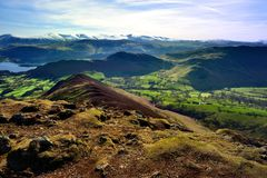 Causey Pike summit over the Derwent water fells. Snow on the summits of the Helvellyn range March 2017 royalty free stock images