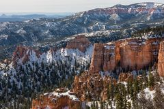Snow and Sun Glisten Across Bryce Canyon Walls. In early spring royalty free stock photography