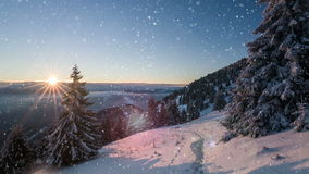Snow and sunrise in the winter mountains stock video footage