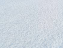 Snow surface under bright sunlight, blue background Stock Image