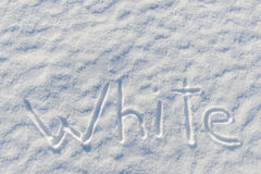 On the snow surface is written Stock Photo