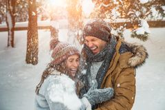Snow surprise. Surprised falling snow couple laughing stock photo