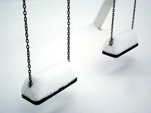 Snow swing Royalty Free Stock Photo