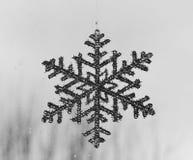Snow symbol - black and white background. Pesaro, Italy Stock Photo