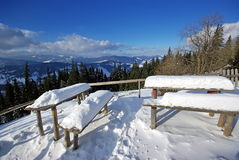 Snow on table and seats Stock Photos