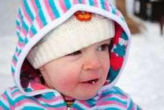 Snow Tastes Good. A baby toddler girl eating snow Stock Photos
