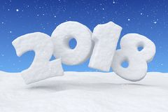 2018 snow text over snow surface under blue sky and snowfall. 2018 New Year sign text written with numbers made of snow over snow surface in snowy field under Royalty Free Stock Image