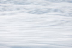 Snow texture background. Snow waves on field in winter Royalty Free Stock Photography