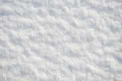 Snow for texture or background at sunny day, bright light with shadows, flat lay, top view, clean and nobody Royalty Free Stock Photos