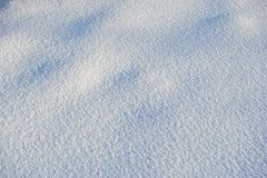Snow for texture or background at sunny day, bright light with shadows, flat lay, top view, clean and nobody Royalty Free Stock Images