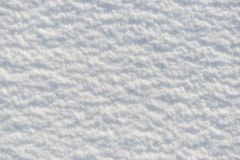 Snow for texture or background at sunny day, bright light with shadows, flat lay, top view, clean and nobody. Snow for texture or background at sunny day, bright Royalty Free Stock Photos
