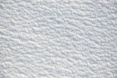 Snow for texture or background at sunny day, bright light with shadows, flat lay, top view, clean and nobody Royalty Free Stock Photo