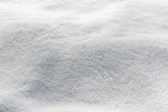 Snow texture in a field. Snow background white in winter day. Season of Cold weather. Crystal snowflake texture abstract stock photos