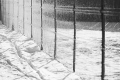 Snow texture with shadows - stripes from a fence Royalty Free Stock Photography