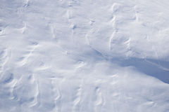 Snow texture, surface created by a wind Stock Photos