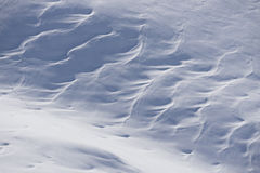 Snow texture, surface created by a wind Royalty Free Stock Image