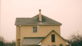 Snow is thick on the background of the building. Ukraine stock video