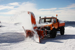 SNOW THROWER AT WORK Stock Photo