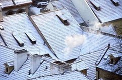 Snow on tile roofs Royalty Free Stock Images