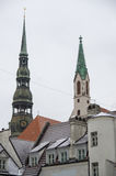 Snow on tiled roofs and spier of the  Saint Peter church in Old Royalty Free Stock Photography