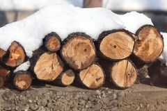 Snow on the timber stack Royalty Free Stock Photos