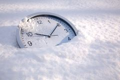 Snow time, a clock in the snow Royalty Free Stock Photo