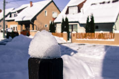 Snow on the top of the fence. In winter stock photography