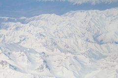 Snow on top of the Himalayas mountain range from the airplane window. Bird eyes view Stock Photo