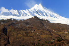 Snow on the top of Manaslu Stock Photography