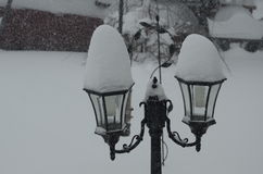 Snow topped latern style lights Royalty Free Stock Image