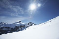 Snow-topped mountain peaks under the sun Royalty Free Stock Images