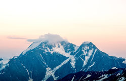 Snow tops of high Mount Elbrus at sunset, mountain landscape, sights and nature Royalty Free Stock Photography