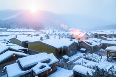 Snow township landscape in sunrise stock image