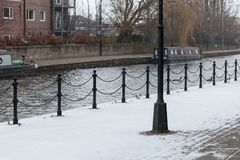 Snow on the Towpath. The light covering of snow on the towpath Stock Photo