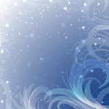 Snow tracery  on a blue background with shine Stock Photos