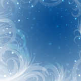 Snow tracery  on a blue background with shine Royalty Free Stock Photos