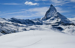 Snow track in front of matterhorn royalty free stock photo
