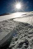 Snow track goes downhill Stock Photo