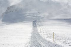 Snow track on mountainside Stock Image