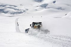 Snow tractor on wintry slope Stock Photo
