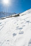 Snow trail ascneding a slope. Maltatal valley in Austria Royalty Free Stock Photography