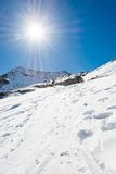 Snow trail ascneding a slope. Maltatal valley in Austria Stock Photography