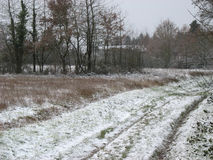 Snow and trail in the countryside Royalty Free Stock Images