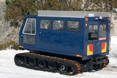 Snow Transport Vehicle. A snow transport vehicle parked outside a chalet at a resort in the Australian Alps Stock Images